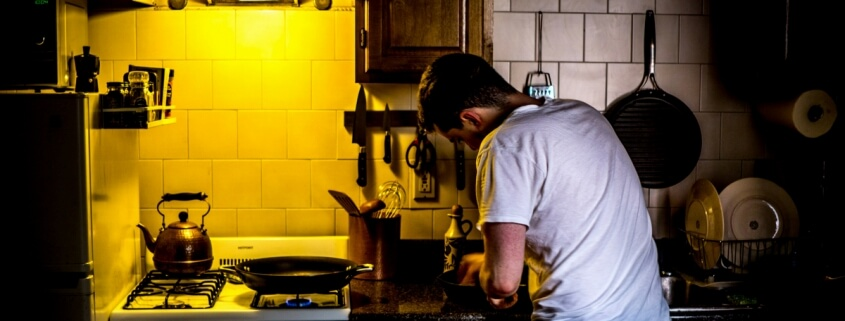 Chef in a kitchen by Aaron Thomas