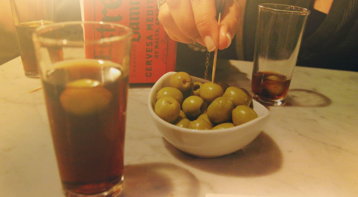 olives and vermut on a marble table