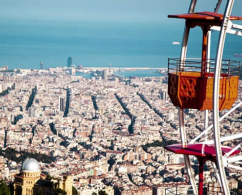 Ferris wheel and view of Barcelona