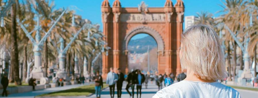Woman looking at Arc de Triomf, Barcelona